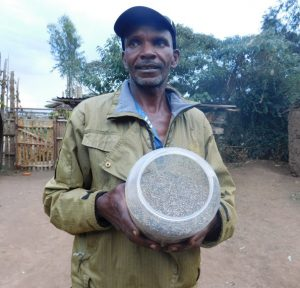 Francis Ngiri showing saved Chia seeds