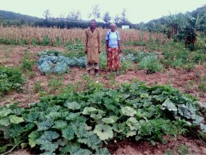 Salome Wambui and Peter Maina on their field in Gilgil, Kenya