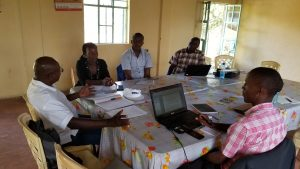 Seed Savers Network Staff with Tom Kore during a mentoring session