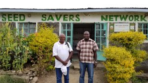 Seed Savers Director, Daniel Wanjama, with KCIC mentor, Tom Kore, in from of Seed Savers Network's office